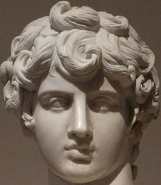 "A close-up of ""The Young Antinous"", Roman bust (2nd century CE) on display at Museo Nazionale Romano, Rome. Antinous was a extraordinary handsome boy. Emperor Hadrian met him in Bythinia and fell in love, taking him to Rome. The emperor wept for Antinous publicly when, in 130 CE. the young man mysteriously drowned in the Nile"