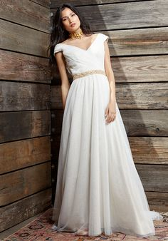 Off-the-shoulder bodice with cross-rouched detail and full gathered skirt in all-over, off white silk net and satin, nude underlay.  *Sash is sold separately.