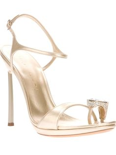 Metallic beige leather pump from Casadei featuring a double toe strap with a contrast gemstone detail, a slim buckle fastening ankle strap, a branded insole and a structured stiletto heel.