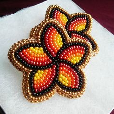 Earrings Handmade My first ever beaded florals! They remind me of fall/autumn colors. I really enjoyed making these and will be making more florals in the future. Posted on my etsy shop. Beaded Earrings Native, Beaded Earrings Patterns, Native Beadwork, Beaded Brooch, Seed Bead Earrings, Hoop Earrings, Earrings Handmade, Embroidery Hearts, Bead Embroidery Jewelry