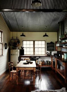 Love the straight forward utility look of this kitchen. Corrugated metal ceiling? Hmmm, I kinda like it.