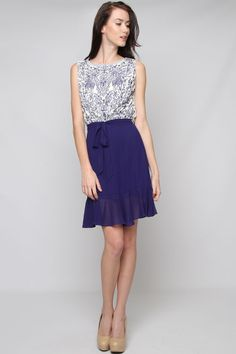 The blue embroidery and deep V back make this a beautifully detailed dress. Also gorgeous/available in orange.
