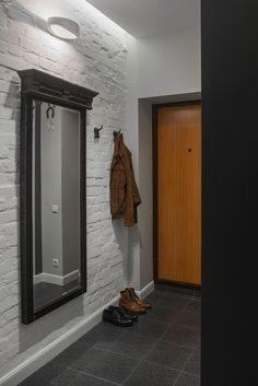 Love the entrance mirror - Compact Bachelor Haven in Moscow Defined by the Mix of Modern with Retro