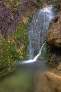 Sitting Bull Falls, New Mexico -- This makes me think of picnics there with grandparents. The area around the falls is lovely and can feel like a secure, happy place to me. I'm guessing that there was a lot of rain the year this picture was taken.