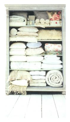 linen bookcase -- idea for the guest room *used this as inspiration for the new bookcase addition to our guest room/office. I placed 2 folded quilts on the bottom shelf and love how it looks!! [08/12]