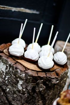 cake pops displayed on rustic tree stump...great display idea for rustic party or wedding