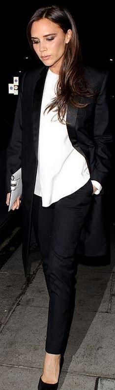 Who made  Victoria Beckham's white shirt, black coat, black pants, and white print clutch handbag?