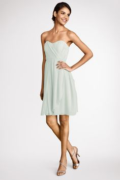 Multi directional pleats add  texture to the  sweetheart bodice of  this pretty hint of mint  chiffon  with extra skirt panels  for convertability.