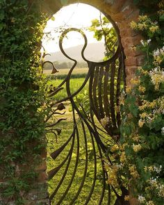 The angel gate in a walled garden in Wocestershire #doorsoftheworld  #dreamlike  Gruppo In Casa -- #ItalianDoors #MadeInItaly #Miami #MiamiStyle #MiamiLife #DoorsOfDistinction #DoorDesign #Doorseries #DoorsOnly #DoorsOnDoors #DoorsWorldwide #DoorsAroundTheWorld #Doors #MiamiLuxury #LivingInLuxury #LuxuryHomes #MiamiHomes #HomeDesign #Architecture #MiamiDesign #InteriorDesign #MiamiInteriorDesign #TopDesign #InteriorDesignMiami #PalmBeach #WestPalmBeach by gruppoincasa http://discoverdmci.com