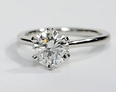 Solitaire diamond engagement ring with a thin band. This ring has a six-prong setting, instead of the usual four, to showcase your center diamond. You can set this timeless ring with a round diamond of your choice.