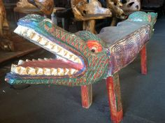 Unique double sided crocodile bench solid wood beautiful hand carvings and colors. $950.00, via Etsy.