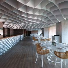 V'ammos Restaurant  by LM Architects. Undulating ceiling and bar made of cooking pots.