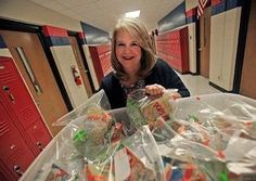 Unsung Hero Kimberly Smith wheels her cart of backpack meals down the halls of Havelock Middle School.