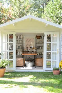 White Garden Shed used as a perfect craft and blogging studio