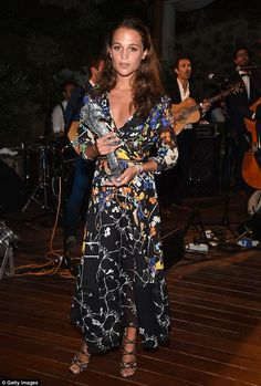 Meanwhile... Alicia, 26, looked stunning in a colourful printed gown, which featured a bil...