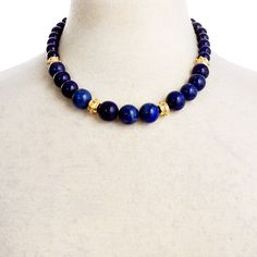 This simple strand of dreamy blue lapis beads will add a vibrant pop of color to…