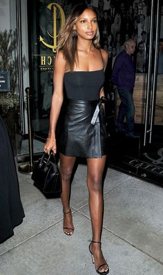 On Jasmine Tookes: Are You Am I Kimia Bodysuit($119); Givenchy Antigona Small Satchel Bag($2280); Adornmonde Gunner Gold Star Hoop Earrings($78).  A master class in how to make...