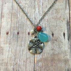 Gorgeous sand dollar necklace by MGreenhalghDesigns on Etsy https://www.etsy.com/listing/463804532/gorgeous-sand-dollar-necklace