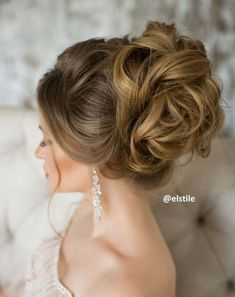 Breathtaking loose wavy updo wedding hairstyle; Featured: Elstile
