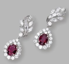 PAIR OF PLATINUM, RUBY AND DIAMOND PENDANT-EARCLIPS Set with oval rubies weighing approximately 4.50 carats, and round, marquise-shaped, baguette and tapered baguette diamonds weighing a total of approximately 4.20 carats, pendants detachable.