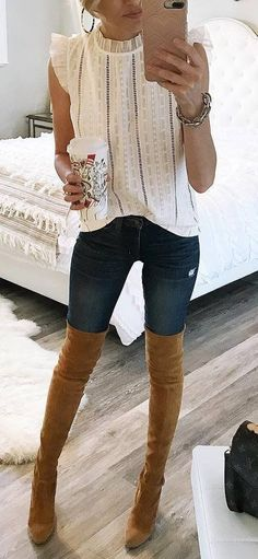 fashionable outfit white blouse jeans brown over knee boots