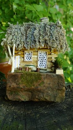 Small shepherd's hut, because the elves also like quiet life :D Made of twigs of pruned apple tree, grass from the meadow next to the house, and various home items. A table with a beer cap brought from Thailand :) #SaveHomeElves #DIY #FairytailHouse #DollyHouse