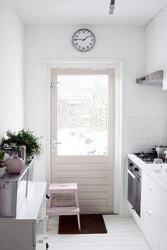 IKEA BEKVÄM step stool, kitchen, unpainted, clock, white walls, natural light