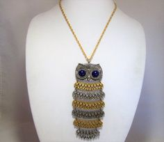 Mid Century 1960s large figural owl pendant necklace Alternating antiqued gold and silver tone rows of feathers, all linked Cobalt blue lucite eyes Signed on back Goldette 21 inch chain, pendant is 5.5 inches long Articulated body Shows no wear to the finish Very good condition I specialize in vintage figural animal jewelry, please visit my shop to see more International buyers welcome, shipping is automatically combined, overcharges refunded Priority shipping is optional 11817   Paypal and…