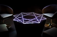 Lighting Table of cut and faceted glass. Illuminated with LED stripes.