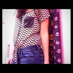 Chevron top Black/white chevron shirt with tie in front and a black leather pocket Charlotte Russe Tops
