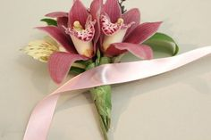 This ribbon ties the corsage to the loop mechanism.