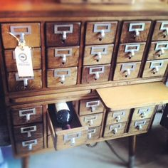 See How a Salvaged Card Catalog Becomes a Great Wine/Anything Storage Unit.   The little shelfs pull out... Can serve cheese and pour a cocktail or two .