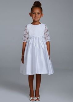 Your flower girl will look beautiful in this exquisitely designed ball gown!  Features delicate lace 3/4 sleeve pop over that gives this dress the ultimategirlish touch.  Bow at back finishes off the look.  Fully lined. Back zip. Imported polyester. Dry clean only.