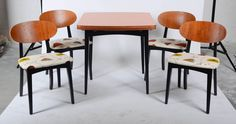 A 1960's G-Plan dining table and four matching chairs newly upholstered in a fabric design from the world renowned Sanderson & Co, to give a near original look.The table top being covered in orange veneer  https://www.1stdibs.com/furniture/tables/dining-room-sets/draw-leaf-table-four-matching-chairs/id-f_1093304/