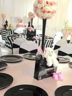 Floral centerpieces at a Chanel baby shower party! See more party planning ideas at CatchMyParty.com!