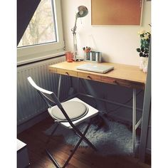 IKEA Lillasen desk with small faux sheepskin rug. Could drape over chair or use as carpet.