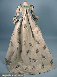 1850-1890 2-piece floral printed mint green silk chine, trained Watteau back, trimmed w/ serpentine bands of green satin ribbon  w/ underskirt of ivory taffeta decorated w/ green ribbon trimmed tulle flounces,
