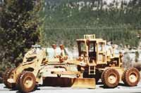 Realistic model of a road grader made from wood. Plans available for the experienced woodworker.