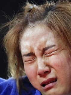 The agony and ecstasy of the Olympics - Bak Ji-yun of South Korea cries after her loss to Alice Schlesinger of Great Britain during the women's 63 kg judo