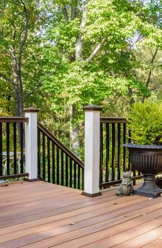 This beautiful installation features Horizon Fiberon Composite Decking in Ipe, brown railing, and white posts.