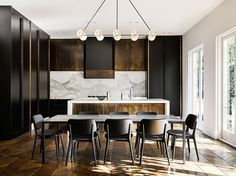 """The kitchen joinery is a rich synergy of clean American oak with a black two-pack lacquer finish and honed Calacatta kickers. Overhead, folded bronze panels are inherently flawed. """"Putting the handmade into this very structured place balances everything out,"""" says David. interior designer David Flack in renovating this Melbourne home"""