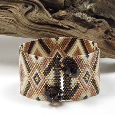 A beautiful bracelet in RICH autumn colors. My photos really dont do this bracelet justice. This bracelet has been beaded in peyote stitch,