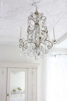 love the chandelier and room .. tin ceilings .. love