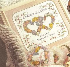 Counted Cross Stitch Wedding Sampler Flowers of the Heart Pattern Chart Ringbearer Pillow. $4.99, via Etsy.
