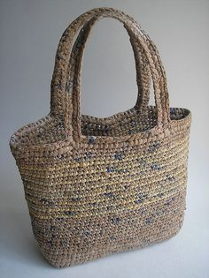 "crocheted plarn bag by Thoughtful Rose, she used 1"" loops of plarn, and a size H crochet hook. Tight, dense stitches are the key to a plarn bag that won't stretch out of shape (that, and crocheting through both loops)."