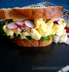 Classic Egg Salad Sandwich is bumped up a few notches with shallots marinated in Dijon and vinegar. Radishes and black olives add to the taste and visual appeal!