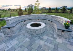 Where you place your fire pit is a critical design detail. Factors such as wind, seating, and shape all play a part in fire pit placement. Ask yourself these questions before you decide where to place your new fire pit. Fire Pit Seating, Fire Pit Area, Wall Seating, Fire Pit Backyard, Backyard Patio, Fire Pit Wall, Garden Fire Pit, Backyard Seating, Outdoor Pergola