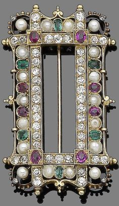 A late 19th century gem-set, pearl and diamond brooch. Of Gothic inspiration, the large openwork rectangular plaque, composed of four old brilliant-cut diamond lines highlighted at their intersection with oval-cut rubies in square collet-settings, within a pearl and half-pearl, similarly-cut ruby and step-cut diamond surround, decorated with rose-cut diamonds, beading and scrolling details. #NeoGothic #Victorian #brooch