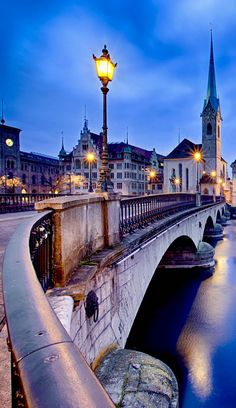 Beautiful View on Fraumunster Church and Church of St. Peter at night, Zurich, Switzerland  | See why Switzerland is the Country where Splendor seems to be Endless