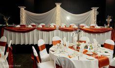 navy blue and burnt orange reception | Reception: Burnt Orange Satin Tablecloths & 4-Pillar Backdrop